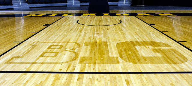 """FILE - In this Oct. 11, 2011, file photo, the new Big Ten Conference logo """"B1G"""" is stained into the wood of the newly-renovated Crisler Arena court during NCAA college basketball media day in Ann Arbor, Mich. The Big Ten Tournament begins Wednesday, one week earlier than usual at a rather unusual venue: Madison Square Garden in New York.  (AP Photo/Tony Ding, File)"""
