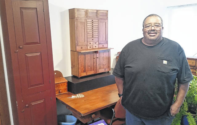 Wendell Robinson's home is filled with his Shaker miniature creations.