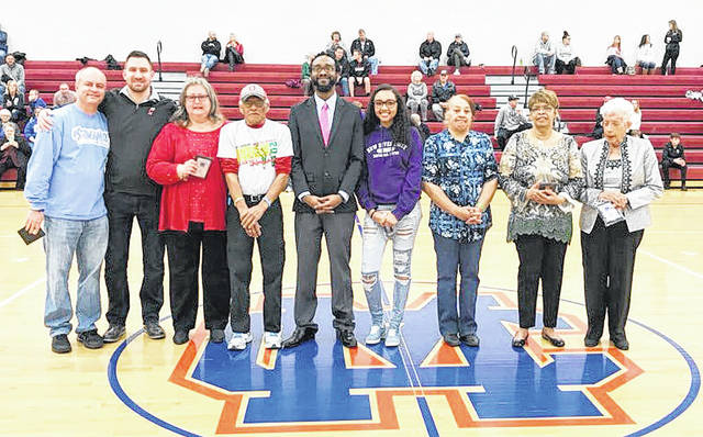"""The 2018 class of the Clinton-Massie athletic hall of fame was inducted recently prior to the start of the boys basketball game. Those inducted were Brian Mudd, Pam Rich, Drew Frey, Bob Williams and Harold """"Laz"""" Carter. In the photo, from left to right, Mudd, Frey, Rich Rittinger, and representing Bob Williams are brother Richard Williams, son Brandon Williams, granddaughter Qiara Williams, sister Kathy Williams, wife Peggie Williams and Urcelle Willis, accepting on behalf of Carter."""