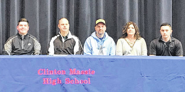 """Clinton-Massie senior Keith Mineer has signed to play golf in college with Huntington University, an NAIA institution located inIndiana. """"Keith will go down as one of the best golfers in Clinton-Massie history. He holds the 18-hole record shooting a 68 atthe SBAAC tournament this year. He's solid in all areas and I look for him to have a successful college golf career,"""" CM golfcoach Brian Mudd said. In the photo, from left to right, Keith Mineer, Huntington coach Rick Sholund, father Jay Mineer, motherJenny Mineer and Zach Mineer."""