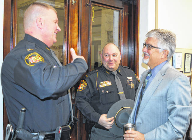 "The need for a body scanner to detect hidden drugs at the Clinton County Jail was a topic before commissioners. From left the top jail administrators, Capt. Justin Drake and Lt. Michael Wahl, chat afterward with Clinton County Common Pleas Judge John W. ""Tim"" Rudduck."