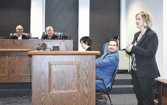 Beth Ellis, a Republican candidate for State Representative of the 91st House District in the May primary election, made a visit to Thursday's Wilmington City Council meeting. Seated are, from left, Mayor John Stanforth, President of Council Mark McKay, City Administrator Marian Miller and Law Director Brett Rudduck.