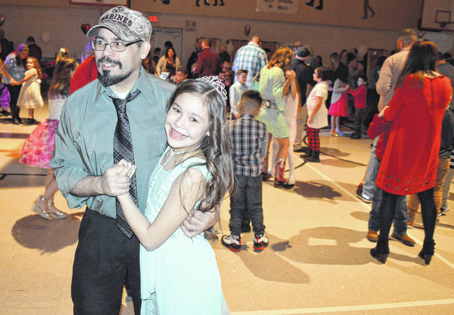 """East End Elementary School held a formal """"Sweetheart Dance"""" on Saturday in the gymnasium. It was well attended by children, parents and grandparents. In the left foreground are Eric Hubbard and his daughter Abbie Hubbard, 9."""