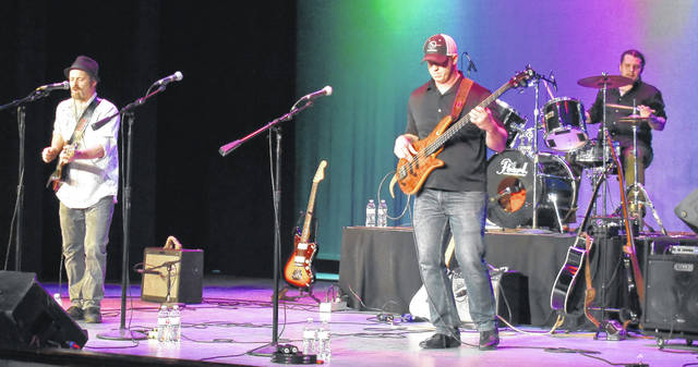Wilmington's Rob Stuckert, far right, plays bass with the Allen Talbott Trio at the Murphy Theatre Saturday night.