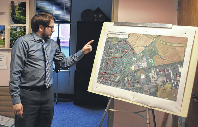 Safety/Service Director Brian Shidaker shows the Streets Committee the planned 2018 Paving Project during Tuesday's committee meeting. Red lines indicate repaving, blue lines indicate crack sealing, and black squares indicate full-depth repair.