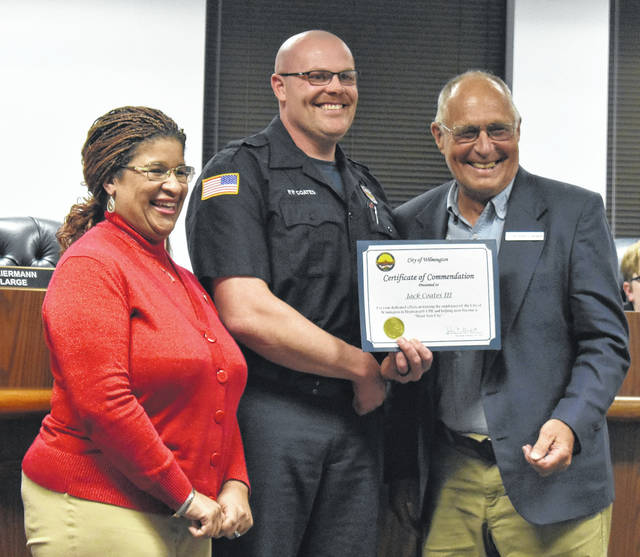 Wilmington firefighter/paramedic Jack Coates, center, was recognized by Mayor John Stanforth, right, with a certificate of commendation during Thursday's council meeting for his efforts in training city employees in HeartSafe CPR. He also thanked Wilmington's HR Director Jeanne Pope, left, for her work with the program.