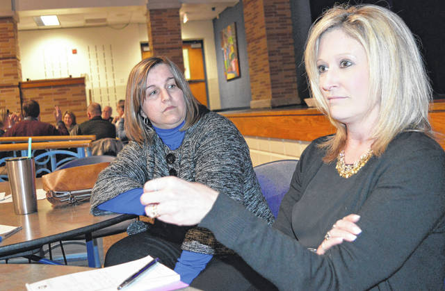 During a small-group discussion at the Tuesday night public forum, Michelle Angelica, right foreground, makes a comment while Chaley Peelle Griffith, center, listens.