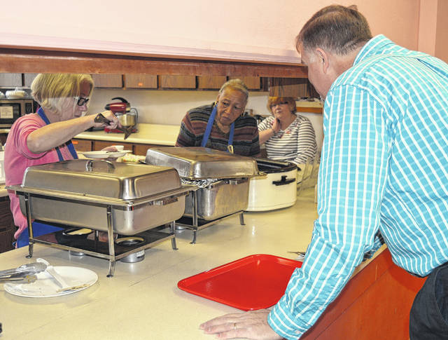 The Wilmington United Methodist Church at 50 E. Locust St. hosted the first of its weekly Lenten lunches on Wednesday in its Fellowship Hall for local residents (including County Auditor Terry Habermehl, shown at counter). These will continue 11 a.m.-1 p.m. each Wednesday through March 28. Cost is $7. On the menu for Feb. 21 are glazed meatloaf, mashed potatoes and gravy, buttered corn, roll and butter, and brownie. For carry-out, call 937-382-1465 and ask for the kitchen.