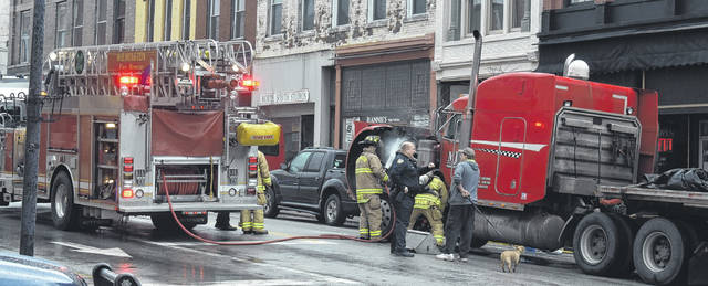 Wilmington Fire and Police Departments responded to a fire in a truck's engine compartment at the intersection of Main and South Streets around 9:30 a.m. on Monday. No injuries were reported, and the truck was later towed from the scene. The cause of the fire has yet to be determined.