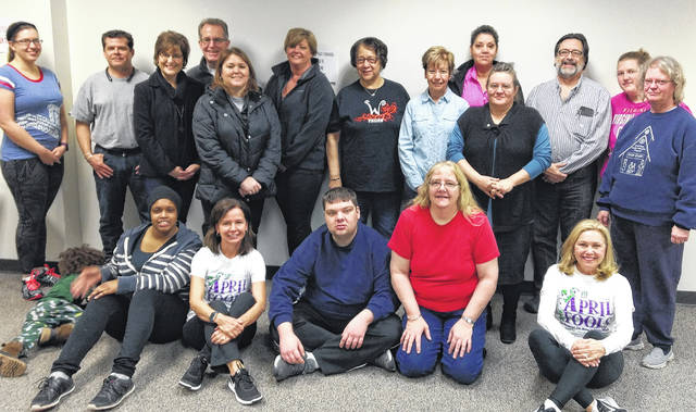 Kathy Havey and Louanne Bloomberg from the Health Alliance of Clinton County are pictured with My First 5K Training Program participants attending last Saturday's registration kickoff event.