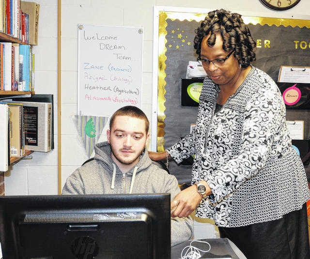 Nina Talley, director of Career Services, assists freshman Zane Cukovecki in looking over how Jobscan can benefit students in their job search.