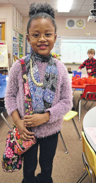 Kyliee Crawford, an East End Elementary School kindergartner, celebrates the 100th day of school Thursday, which is a big deal in kindergarten. Students dressed like they were 100 years old.