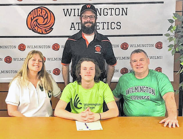 "Wilmington High School senior Blake Frazier has decided to continue his lacrosse career at Wilmington College. ""I am excited to see Blake have the opportunity to play lacrosse at the next level at Wilmington College. He has earned this through developing his skills during the off-season, becoming a better teammate my being a multi-sport athlete and excelling in the classroom,"" Wilmington High School head coach Adam Shultz said. In the photo, from left to right, mother Sandy Frazier, Blake Frazier, Mike Frazier; back row, coach Adam Shultz."
