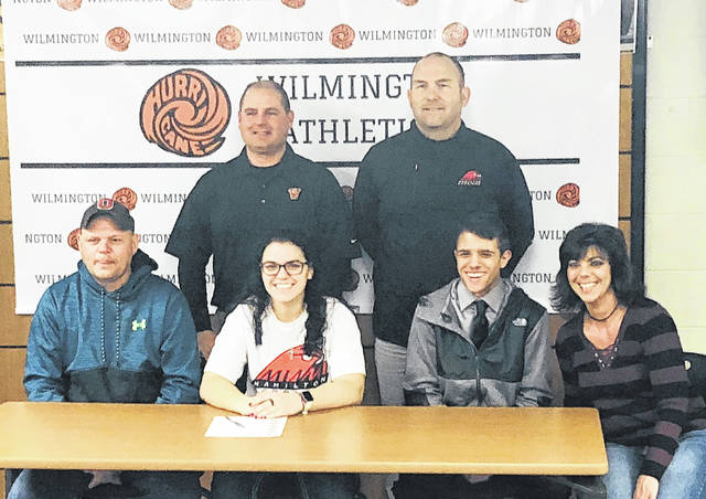 """Wilmington High School senior Courtney Smart has signed to play softball next season with Miami University-Hamilton. Wilmington coach Glen Blessing said, """"Everyone in the Hurricane softball program is extremely proud of Courtney. Her hard work and dedication to the sport of softball has earned her the opportunity to continue her softball career at the collegiate level. It's an honor and pleasure to be a part of her journey."""" In the photo, from left to right, front row, Mike Smart, Courtney Smart, Cameron Smart, Shannon Smart; back row, WHS head coach Glen Blessing and Miami University Hamilton head coach Rick Walker."""