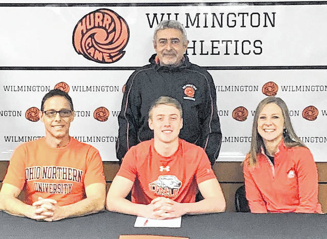 """Wilmington High School senior Seth Gundlach has decided to continue his soccer career at Ohio Northern University. WHS boys soccer coach Imad El-Macharrafie said, """"Seth has developed into a highly-skilled soccer player who is capable of playing any position on the field. I'm sure that he will be a great addition to Ohio Northern University's men soccer program."""" In the photo, from left to right, front row, Steve Gundlach, Seth Gundlach, Heather Gundlach; back row, WHS boys soccer coach Imad El-Macharrafie."""