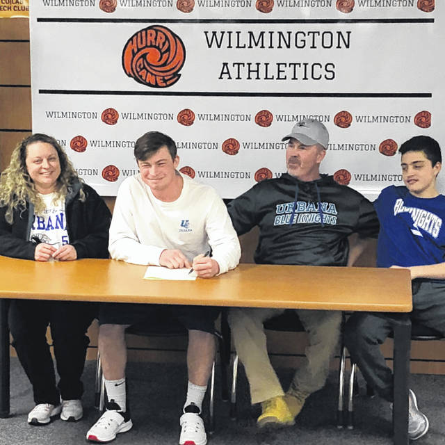 """Wilmington High School senior Brett Bell has selected Urbana University to continue his baseball career next season. WHS baseball coach Dusty James said, """"As long as I have known Brett, he has been the type of kid who goes all out all the time. He wants to win. Brett's success in baseball, football, and in life is a direct representation of the type of person he is. A great leader. He never settles for anything less than his best and holds his teammates to that level as well. Urbana should be very happy to know that they are receiving a tough kid who will do anything you ask of him. I am excited to see how his senior year plays out. He will be missed in the baseball program and our younger guys will have big shoes to fill moving forward."""" In the photo, from left to right, Amanda Bell, Brett Bell, Bryann Bell, Leyton Bell."""
