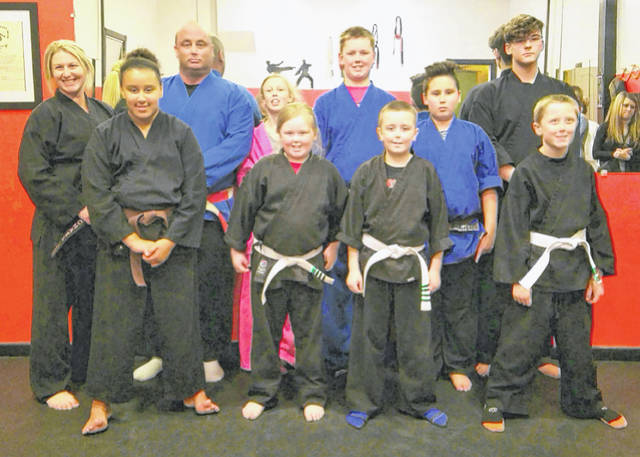 Students of the Bushido Dragons karate school participated in the Way Warriors tournament Saturday at the Wilmington Church of Christ. In the photo, from left to right, are students and their awards along with Bushido Dragons instructors, front row, Sophia Reyes, 1st place grappling, sparring, kata, 2nd place weapons kata; Asa Mason, 1st place weapons kata, kata, sparring, 3rd place grappling; Marshell Mason, 1st place kata, weapons kata, 3rd place sparring; Manny Castillo, 1st place sparring, weapons kata, 2nd place kata; Quinton Bowman 2nd place grappling; back row, Sensei Rachael Williams; Master JD Williams; Gracie Bowman, 1st place grappling, kata, sparring; Talon Bowman 2nd place grappling; Sensei Gehrig Huber.