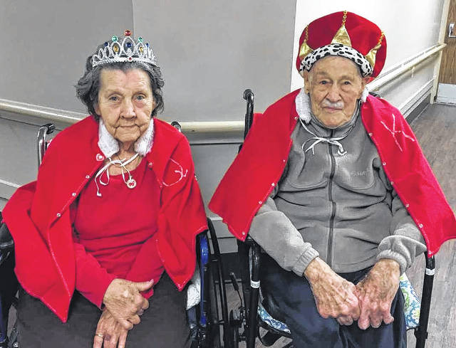 Continental Nursing & Rehabilitation Center has a monthly birthday party to celebrate the residents having a birthday within that month. February's birthday party was extra special because a new King & Queen of Hearts were crowned. This years title of Queen went to Phyllis Hixson, with King going to Robert Ernst. Activity Director Lisa Beach said they gather all of the residents in the dining hall to await the grand entrance. Last year's King, Larry Tedrick, led the way as they entered the hall. Once inside the hall, Larry Tedrick then handed over the scepter to the new King, Robert Ernst. Last years queen, Wilma Palmer, then handed over the scepter to the new queen, Phyllis Hixson. The residents enjoyed cake, ice cream and punch while enjoying the entertainment courtesy of Mike Mallot and Intelli Choice Insurance. Gifts were presented to the King and Queen, as well as all of the residents with birthdays in the month of February. Family members of both Phyllis and Robert were present to help them celebrate.