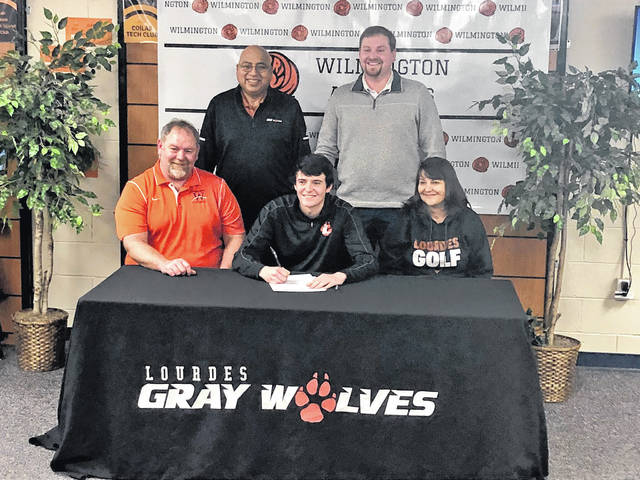 "Wilmington High School senior Hunter DeWeese has chosen Lourdes University to continue his golf career. Hurricane head coach Phil Gilmore said, ""Hunter was the unspoken leader of the team. He has a terrific work ethic and he demonstrated it every day that he was a part of the Hurricane golf team. He also showed his teammates the work ethic necessary to become a better golfer and his teammates fed off that. He also united the golf team and helped them, especially all four seniors, to become good friends. He and his fellow co-captains were the foundation of a successful reconstruction from 2014 to 2017, and I could not be more proud of the golfer and young man that he has become."" In the photo, from left to right, front row, Dwayne DeWeese, Hunter DeWeese, Kim DeWeese; back row, Lourdes University golf coach Gil Guerrero, and WHS golf coach Phil Gilmore."