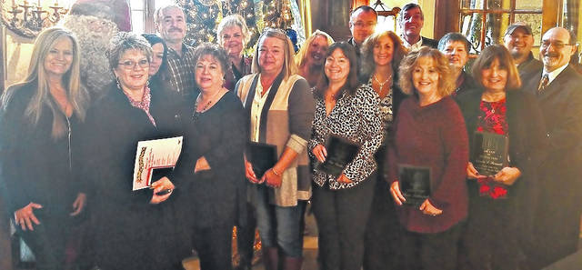 The Clinton County Board of Realtors presented awards to the top-ranking sellers for 2017. They are from left Shelly McCune, Connie Gray, Leah Grant, Chuck Rich, Melissa Reeder, Brenda Barr, Robyn Clifton, Tracy Meares, Sue Walker, Larry Britain, Cheri Honnerlaw, Sheri McIntosh, Ray Sarkees, Betsy Hart, Marsha Bennett, Ryan Frommling and Steve Riehle. Honorees who were not present for the photo are Jarad Holmes, Susan Utley, Billy Arehart and Brian Prickett.