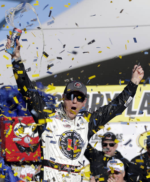 Kevin Harvick celebrates after winning a NASCAR Cup series auto race Sunday, March 4, 2018, in Las Vegas. (AP Photo/Isaac Brekken)