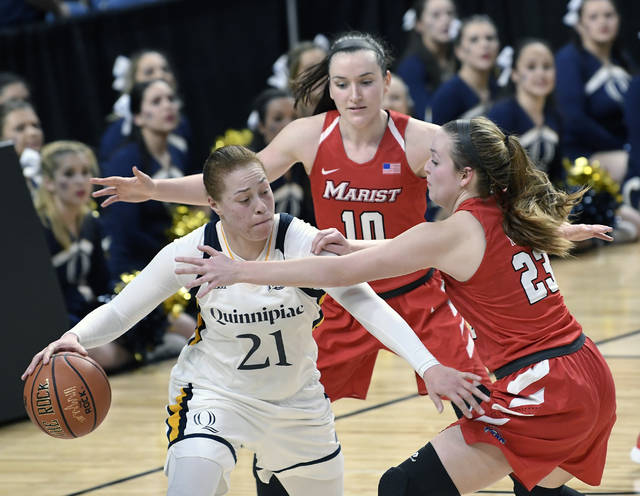 FILE - In this March 5, 2016, file photo, Quinnipiac forward Jen Fay (21) moves the ball against Marist's Maura Fitzpatrick (10) and Rebekah Hand (23) during the second half of an NCAA college basketball game in the championship of the Metro Atlantic Athletic Conference tournament in Albany, N.Y. Fay enjoyed her team's NCAA Tournament breakthrough last year so much that she wants to deliver a repeat performance. (AP Photo/Hans Pennink, File)