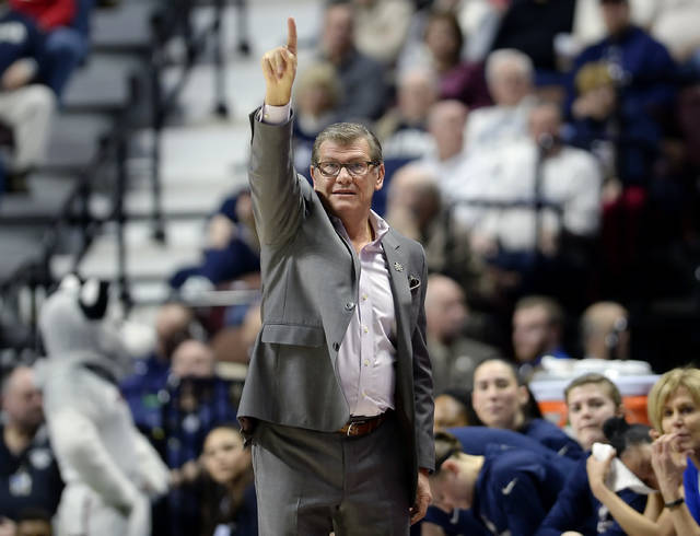 FILE - In this March 6, 2017, file photo, Connecticut head coach Geno Auriemma gestures to his team during the first half of an NCAA college basketball game against South Florida in the American Athletic Conference tournament finals in Uncasville, Conn. UConn finishes No. 1 in The Associated Press women's basketball poll for the fifth straight year. The Huskies (32-0) enter the NCAA Tournament as the lone unbeaten team and went wire-to-wire as the unanimous top team. They received all 32 votes from the national media panel Monday, March 12, 2018. (AP Photo/Jessica Hill, File)
