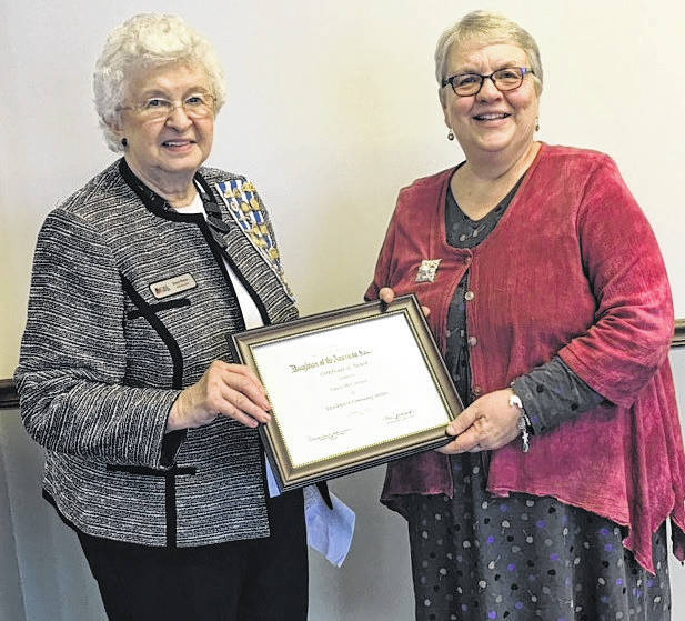 Joyce Peters, Community Service Chair, with award recipient Nancy McCormick.