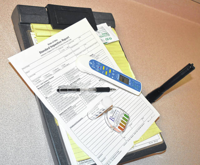 The tools of the trade of a Clinton County health inspector include — along with a lot of education and experience — a flashlight, thermometer, test strips and sanitizing wipes.