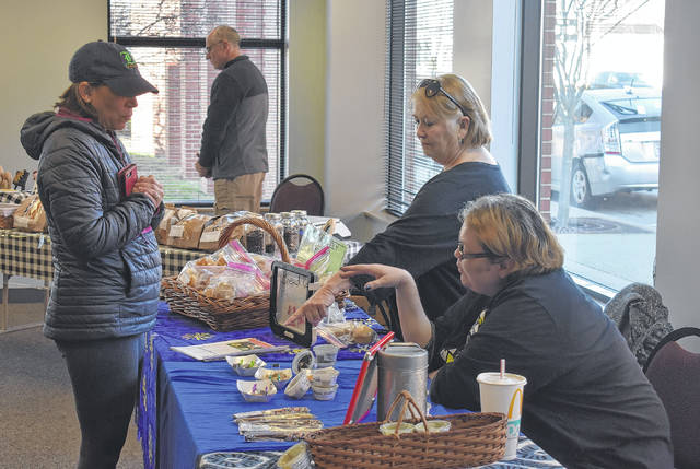 The Clinton County Spring Farmers Market for 2018 debuted last Saturday and continues from 9 a.m. to noon Saturdays inside the Wilmington City Building Moyer Community Room. Shown, Cynthia Green, left, checks out the treats Sue Morrison, center, and April Elliott have at Creatively Good Baked Goods and Fudge during the market last Saturday. Green was in town from New Jersey because her daughter was riding at the World Equestrian Center and she decided to check out the Farmers Market through word-of-mouth.