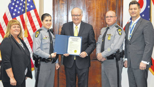 Not only is the State Trooper of the Year for the Ohio State Highway Patrol (OSHP) stationed at the Wilmington post, but Brittany N. Noah is a graduate of East Clinton High School and also earned a bachelor's degree in criminal justice at Wilmington College before receiving a Wright State University master's degree. On Monday, Clinton County commissioners presented her with an official proclamation to congratulate her on behalf of the county on being chosen 2017 Ohio Trooper of the Year. Noah told them she likes people and likes talking with people, and had wanted to do something where she would have direct contact everyday with people and help them. From left are Clinton County Commissioner Brenda K. Woods, Brittany Noah, Clinton County Commissioners President Patrick Haley, Wilmington (OSHP) Post Commander Lt. Stan Jordan and Clinton County Commissioner Kerry R. Steed.