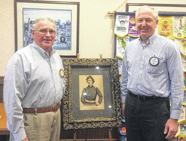 From left, Gary Kersey, Abraham Lincoln-era lecturer, an 1870 lithograph of Elmer Elsworth, and Bob Schaad, President of the Wilmington Rotary Club.