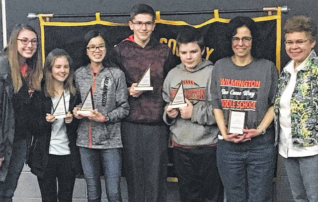 Students that won fourth place in the team competition and their coaches: Coach Jennifer Steinmetz, Katie Pittman, Lilly Middleton, Nathan Wood, Charles Mountjoy, Coach Rebecca Haberlandt, and Math Counts Regional Coordinator Aurea Rivera.