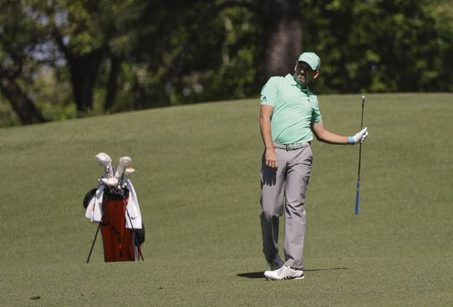 Sergio Garcia, of Spain, watches his shot on the second hole during the first round at the Masters golf tournament Thursday, April 5, 2018, in Augusta, Ga. (AP Photo/David J. Phillip)
