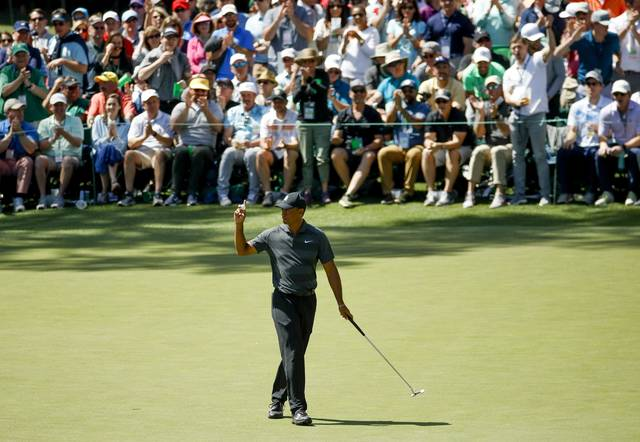 Tiger Woods reacts after a birdie on the 16th hole during the first round at the Masters golf tournament Thursday, April 5, 2018, in Augusta, Ga. (AP Photo/Charlie Riedel)