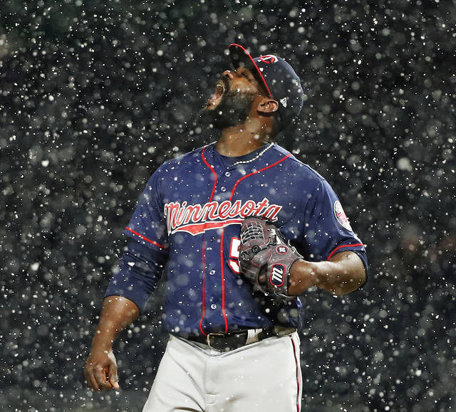 Minnesota Twins relief pitcher Fernando Rodney stands on the mound during a snow squall in the ninth inning of the team's baseball game against the Pittsburgh Pirates in Pittsburgh, Wednesday, April 4, 2018. The Twins won 7-3. (AP Photo/Gene J. Puskar)