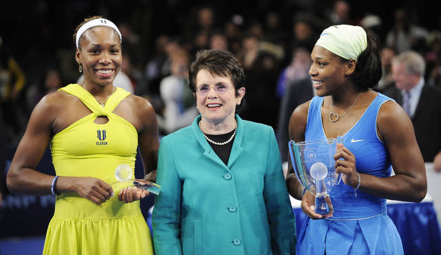 FILE - In this March 2, 2009, file photo, Billie Jean King is flanked by Venus, left, and Serena Williams after Serena defeated Venus in the championship match of the Billie Jean King Cup tennis exhibition, at Madison Square Garden in New York. Venus and Serena Williams are adding their names and voices to the push for equal pay championed by the Billie Jean King Leadership Initiative. The two current tennis stars are joining the advisory board of the group founded by the former player. (AP Photo/Stephen Chernin, File)