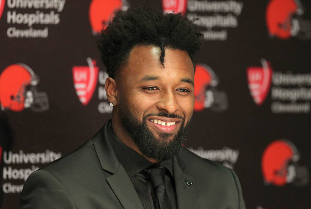 FILE - In this March 15, 2018, file photo, Cleveland Browns' Jarvis Landry speaks at an NFL football press conference in Berea, Ohio. A person familiar with the negotiations says the Browns are close to finalizing a contract extension with star wide receiver Jarvis Landry. The sides remain in talks but expect to get a deal done, said the person who spoke Thursday, April 12, 2018, to The Associated Press on condition of anonymity because the deal has not been finalized.(Joshua Gunter/The Plain Dealer via AP, File)