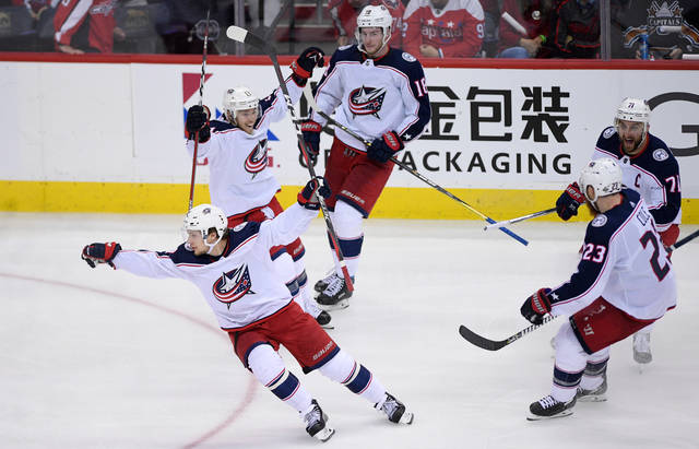 Columbus Blue Jackets left wing Artemi Panarin, front, of Russia, celebrates his game-winning goal with Cam Atkinson (13), Nick Foligno (71), Ian Cole (23) and Pierre-Luc Dubois (18) during overtime in Game 1 of an NHL first-round hockey playoff series against the Washington Capitals, Thursday, April 12, 2018, in Washington. The Blue Jackets won 4-3. (AP Photo/Nick Wass)