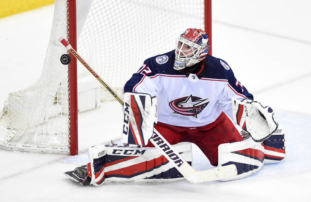 Columbus Blue Jackets goaltender Sergei Bobrovsky (72), of Russia, stops the puck during the third period in Game 2 of an NHL first-round hockey playoff series against the Washington Capitals, Sunday, April 15, 2018, in Washington. (AP Photo/Nick Wass)