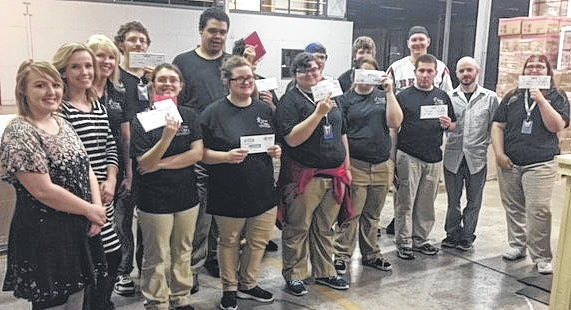 CareerX students display their first paychecks.