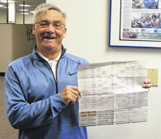 Andy Copeland of Wilmington, shown with his NCAA men's basketball bracket, was the winner of the News Journal March Mania bracket contest. He will be awarded the $200 grand prize out of the many brackets submitted by the community.
