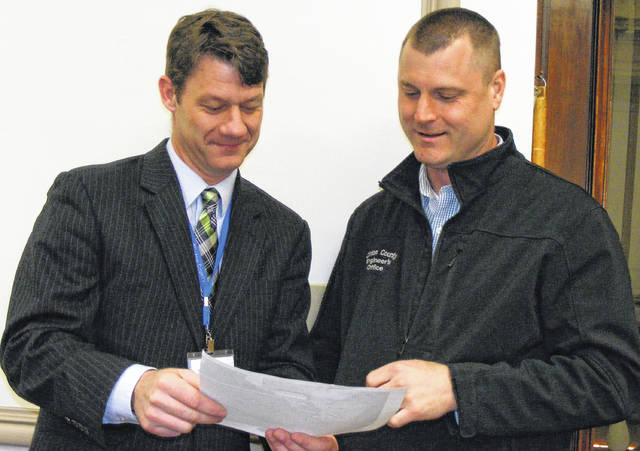 Prior to the hearing on Dakins Chapel Road, Clinton County Commissioner Kerry R. Steed, left, and Clinton County Deputy Engineer Adam Fricke review a map of the area.