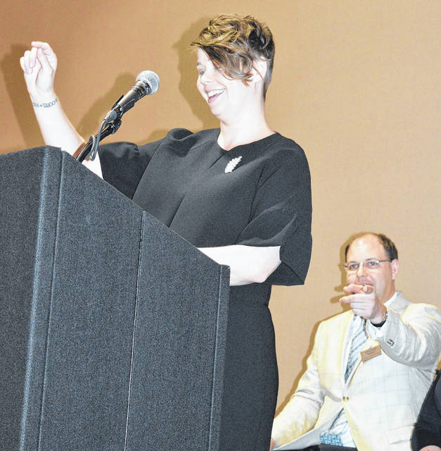 Members and guests packed the Roberts Centre Friday — a testament to the Wilmington-Clinton County Chamber of Commerce's growth the past few years — as the organization held its annual meeting and luncheon. Shown, Executive Director Dessie Rogers welcomes everyone and gives a report on the chamber's year. Seated is chamber board member Jonathan McKay.