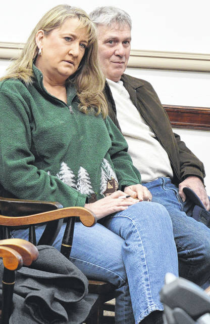 """Pauline """"Shay"""" and Herman Doak attend a discussion Wednesday between Clinton County commissioners and their legal counsel regarding a decommissioned communications tower on county-owned land that's next to property owned by the Doaks."""