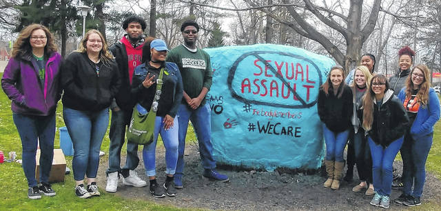 In conjunction with Sexual Assault Awareness Month, the boulder on the Wilmington College campus was spray-painted teal this week. Teal is the color of the themed ribbon. Later in the evening, people were asked to paint messages to victims on the rock.