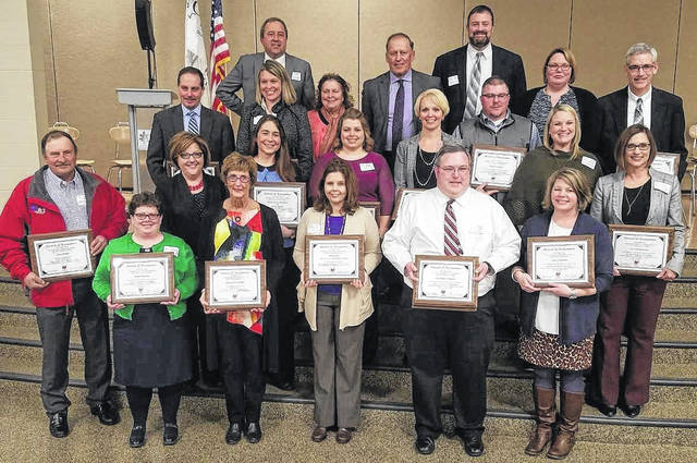 From left are: front, Lisa Beresford, Margie Eads Walker, Stacy Camp, Jason Jones, and Jennie Pierson; second row, Doug Hauke, Shelly Bailey, Jennifer Updike, Melanie Ohnewehr, Kara Williams, Michael Snider, Kristin Unversaw, and Mindy McCarty-Stewart; third/fourth rows (blended), Eric Wayne, Michael Bick, Maggie Lyons, Alana Walters, Tim Walters, David Lewis, Angela Godby, and Rich Seas.