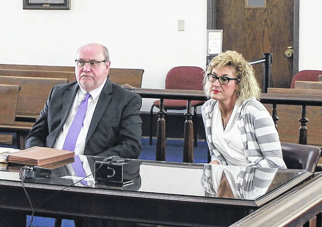Rhonda Smalley, right, sits in Highland County Common Pleas Court during a plea hearing Wednesday with defense attorney Bruce Wallace, left.