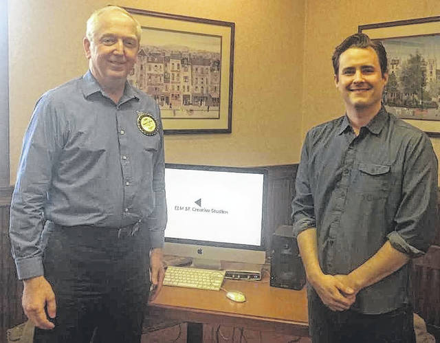 From left are Wilmington Rotary President Bob Schaad and Jesse Littleton of Elm Street Creative Studios