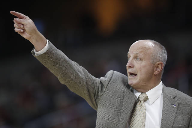 FILE - Int his Nov. 13, 2017, file photo, Western Carolina head coach Larry Hunter directs his players during the first half of an NCAA college basketball game against the Cincinnati at BB&T Arena in Newport, Ky. Western Carolina spokesman Daniel Hooker said Hunter's wife Mary told him the coach died Friday, May 4, 2018, at a Cary hospital after suffering a stroke earlier in the week. He was 68 and had stepped down at Western Carolina in March after his team went 13-19.  (AP Photo/John Minchillo, File)
